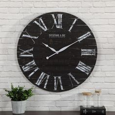 FirsTime FirsTime and Co.® Midnight Planks Wall Clock at Lowe's. Nothing ties a room together better than a great clock, and the one you choose to place in your home should reflect your personality and style. Farmhouse Wall Clocks, Rustic Farmhouse Decor, Black Round Table, Oversized Clocks, Black Clocks, Plank Walls, Wood Clocks, Vintage Farm, Ship Lap Walls