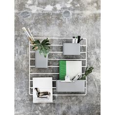 The String Works Grid Wall Organiser is the latest addition to the String shelving storage system. Three storage pockets hang from a wall mounted metal grid – perfect for the well-organised home or office. Wall Organization, Wall Storage, Wire Grid Wall, Wand Organizer, String Regal, String Shelf, String System, Metal Grid, Shelving Systems