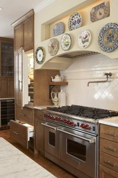 For the serious chef! Wolf range and pot filler in French Provincial kitchen