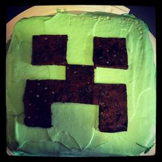 Minecraft creeper chocolate cake. The eyes and mouth are ice cream sandwich outsides lol.  Success!