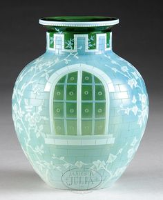 WEBB CAMEO WINDOWPANE VASE.  Spectacular detail cameo decoration of three windows with ivy climbing up the sides on a brick pattern decoration. Coloration consists of white over gray on a green base glass. Signed on the underside with an acid etched Webb signature. SIZE: 6-3/4″ t x 4-3/4″ dia. CONDITION: Very good to excellent. 5-65907 (20,000-30,000)
