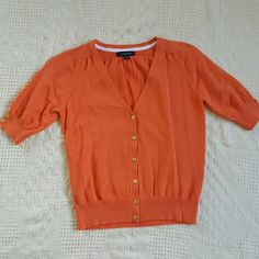 Lands End short sleeved cardigan. Very fun, bright orange cardigan in almost new condition! Gold buttons give it such a classy look. Great for any occasion :)  smoke free home. Lands' End Tops Button Down Shirts