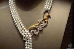 "Piaget, details, necklace in white gold and yellow gold, with pearls and pear shaped diamonds ""Secrets & Lights"" –A Mythical Journey by Piaget"