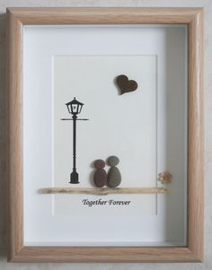 This is a beautiful small Pebble Art framed Picture of a Couple - Together Forever handmade by myself using Pebbles, Driftwood, Wooden Heart and Fabric Flower Size of Picture incl Frame : approx. 22cm x 17cm This Picture is finished and only available as shown in Photo Thanks for looking Doris Facebook: https://facebook.com/Pebbleartbyjewlls4u Product Code: P - Pink