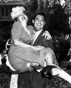Gossip columnist Hedda Hopper and Cary Grant.