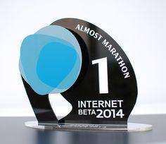 Statuetka z okazji minimaraton -AlmostMarathon przez InternetBeta 2014. Wykonana z pleksi bezbarwnej, czarnej i laminatu grawerskiego. Wysokiej jakości biała folia przyklejana na czarnej pleksi pozwoliła efektownie wyeksponować napis znajdujący się na statuetce.