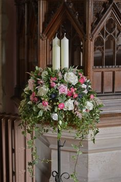 church weddings | Church pedestal flowers with candles using roses, thistles, freesias ...