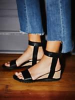 Three Capes Wedge Sandal   Leather wedge sandals featuring an ultra-modern silhouette. Adjustable hook and loop fastener ankle strap makes for an easy on-off. Treaded sold and padded footbed for extra support.