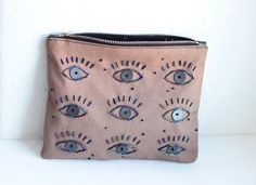 EYES// Zipper clutch// Hand beaded purse by CosmosBits on Etsy, €46.00