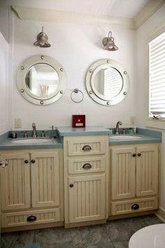 Nautical bathroom.  I don't really like this bathroom, but I like the idea of a nautical bathroom with a single sink/mirror/light fixture.