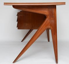 Italian Mid-Century Laminate Writing Desk | From a unique collection of antique and modern desks and writing tables at https://www.1stdibs.com/furniture/tables/desks-writing-tables/