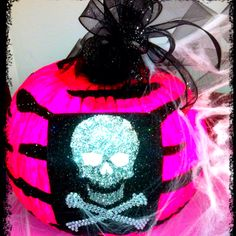 2011 pumpkin First we painted it neon pink; Then we painted black stripe designs with black glitter. We added the black ribbon on top, and the felt blinged out skull. Very cute!