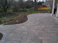 www.bahlerbrothers.com  The patio came out beautiful. Laid in Techo-Bloc's Blu 60 in Champlain Gray, created to mimick natural bluestone.