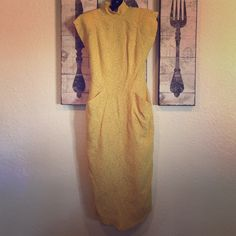 Vintage yellow polka dot wiggle dress Gorgeous vintage dress. Hard to capture full beauty. Yellow with pockets. Open back with buttons. Waist across approx 13in. Full length 48in from neck to hem. Back comes up to inverted v.has shoulder pads. Xs/small Dresses Maxi