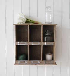Wall shelf with six storage compartments