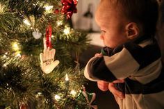 Capturing a child's first Christmas by photographing him with a commemorative ornament.