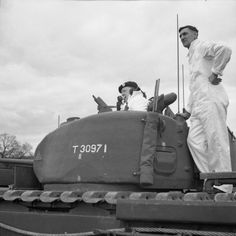 Winston Churchill in the turret of a Churchill I tank during a demonstration of the new vehicle at Vauxhall's at Luton, 23 May 1941.