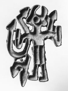 """Openwork stamp seal Central Asia Bactria-Margiana. late 3rd-2nd Milenenium BCE. or """"compartmented"""" seal, cast in both geometric or figural patterns are distinctive to that region. A copper-alloy male figure dressed in a short kilt and mountain boots with upturned toes. If his horned headdress is similar in meaning to examples found in Mesopotamia and Iran, the figure may be divine. The arrow-shaped forms emerging from his shoulders and under his arm may represent snakes or lightning bolts."""