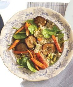 Heat oven to 425° F. On 2 rimmed baking sheets, toss the carrots and mushrooms with the oil, ½ teaspoon salt, and ½ teaspoon pepper. Roast, tossing once, until tender, 15 to 20 minutes. Combine the vegetables in a large bowl and toss with the lemon juice and thyme. Meanwhile, cook the quinoa according to the package directions. Divide the spinach among plates and top with the warm quinoa and vegetables. Sprinkle with the pistachios and drizzle with the oil.