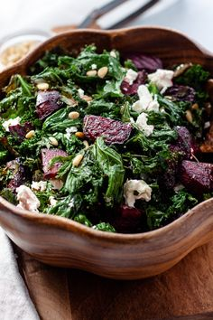 If you like kale chips, you'll love this Crispy Kale and Beet Salad that's loaded with pine nuts and feta cheese and served with a lemony-rosemary dressing. | KateSLyon.com #beets #kalesalad #beetandkalesalad #fetacheese #pinenuts #glutenfree
