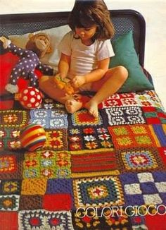 Colourful crochet granny-square mixed blanket.