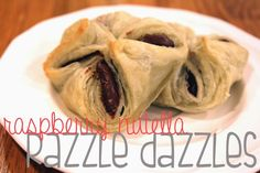 Raspberry-Nutella Razzle Dazzles: the combo of buttery, flaky crust and gooey, chocolately, berry filling is a little piece of heaven. Makegrowdo.com