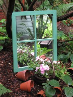Mirror in the garden. SFH adds: even this small window frame with mirror is effective tucked in this little vignette; effective and interesting.