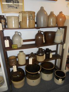 Crocks ~ I have several of the ones on the floor.  Love them.  I have one like the large tan open crock on the top shelf.  Have a couple of the jugs, too.  Love all of them!