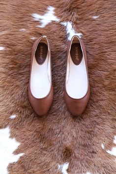 A simple dark brown ballet flat that will compliment just about any outfit and won't kill your feet. View More Colors - Man made materials - Heel height: flat - Toe: Round - Style: Minimalist - Slip o