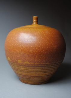 Clay Covered Jar  Orange by JohnMcCoyPottery on Etsy, $85.00   www.etsy.com/shop/JohnMcCoyPottery. Use coupon code SummerVacation to receive 20% off any item in my shop.