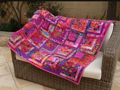 kaffeFassett quilt by jn111, via Flickr - a half-log cabin (small square and 5 embellishing rows) - easy to assemble - great ideas for colour