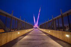 Echo Effect exterior fixtures by SPI Lighting light this pedestrian bridge to ensure safe passage across.