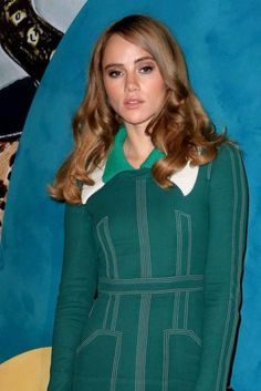 Suki Waterhouse looked demure and gorgeous in a floor length green dress that was covered with sewn in patterns all over the front and had a curve hugging design, which helped emphasize her slender waist and flaunt her svelte figure as she posed for the cameras at the event at Burberry's Regent Street flagship store on June 10, 2016 in London, England. The event was held as part of London Collections Men weekend.