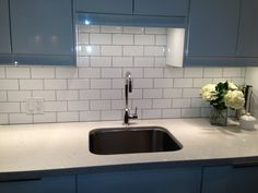 White subway tile and grey grout add interest to my white on white kitchen-materials were under $300