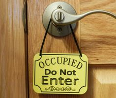 Make it seriously clear that they shouldn't even bother knocking with this cute (and practical!) door decor. You need this funny sign in your bathroom!