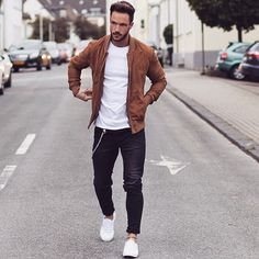 Try teaming a cognac suede bomber jacket with black jeans for a casual level of dress. Tap into some David Gandy dapperness and complete your look with white low top sneakers. Shop this look on Lookastic: Mode Masculine, Men Looks, Mode Man, Modern Mens Fashion, Men Fashion Casual, Fashion Menswear, Trendy Fashion, Herren Outfit, Men Street