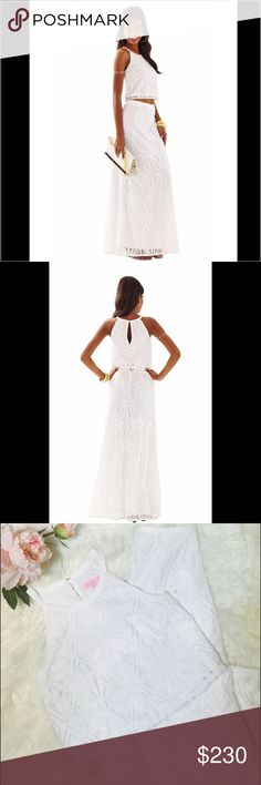 """HPLilly Pulitzer Nicole Crop Top & Maxi Set D11-This unique white lace two piece set is perfect for a special occasion. It's the kind of showstopper that every girl needs in their closet. Two Piece Lace Top And Maxi Skirt Set. Delray Diamond Lace (100% Polyester). Imported. Flat across @ Bust: 15"""", Flat across @ waist 12.5"""".  Top waist to bottom hem: 39"""". NWOT Lilly Pulitzer Dresses Maxi"""