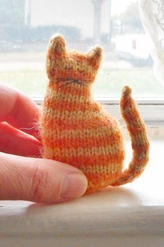 Free Knitting Pattern for Tiny Window Cat - It's 3 inches tall, worked in the round, and all in one piece except for the tail. Designed by Sara Elizabeth Kellner