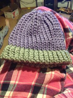 The newest baby hat my husband loomed