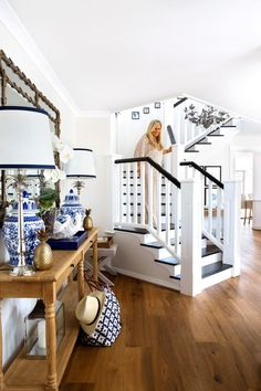 """Natalee descends the elegant central staircase.  **Console** and **mirror** from [Restoration Hardware](https://www.restorationhardware.com/?utm_campaign=supplier/