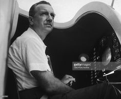 American broadcast journalist Walter Cronkite sits inside a Project Mercury space capsule, located at the CBS News Control Center in Cape Canaveral, Florida.