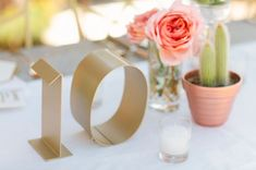 Gold table numbers look lovely on a festival themed boho chic wedding. The mini cactus is adorable. Chic Wedding, Wedding Trends, Spring Wedding, Wedding Details, Our Wedding, Dream Wedding, Wedding Ideas, Wedding Gold, Wedding Hire