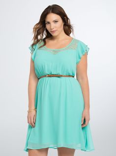 "<p>Ruffles paired with lace; this skater dress isn't short on sweetness! Light as air seafoam chiffon layers over a slip underlay, while the lace inset lets a hint of skin peek out. Ruffled sleeves lend a flowy feel; a gathered waistline is flattered by a skinny-mini camel belt.</p>  <p> </p>  <p><b>Model is 5'9.5"", size 1</b></p>  <ul> 	<li>Size measures 41"" from shoulder</li> 	<li>Polyester/nylon/spandex</li> 	<li>Hand wash cold, dry flat</li> 	<li>Imported plus size ..."