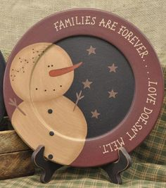 """Families Are Forever Snowman Plate, by The Hearthside Collection. This primitive plate features painted snowman against a black background and burgundy rim. Reads """"Families are forever.Love never melts"""" Measures approx inches. Made of hand-painte Snowman Crafts, Christmas Projects, Holiday Crafts, Snowman Ornaments, Christmas Stuff, Diy Christmas, Christmas Decorations, Painting Pressed Wood, Tole Painting"""