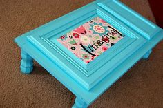 Adorable portable writing/coloring table out of an old cabinet door.