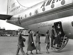 A group of passengers boarding an American Airlines Boeing Stratocruiser.