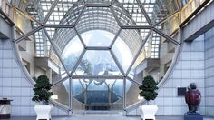 The Ritz-Carlton, Millenia Singapore Cornucopia, a three-tonne sculpture created by Frank Stella, hangs from the ceiling of the lobby, offering guests a glimpse of the hotel's 4,200-piece contemporary art collection.