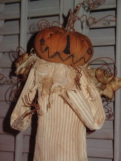 Primitive Pumpkin Angel......use dried stems from last year
