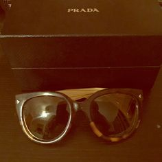Prada sunglasses Cool cat-eye style press sunglasses. Prada Accessories Sunglasses
