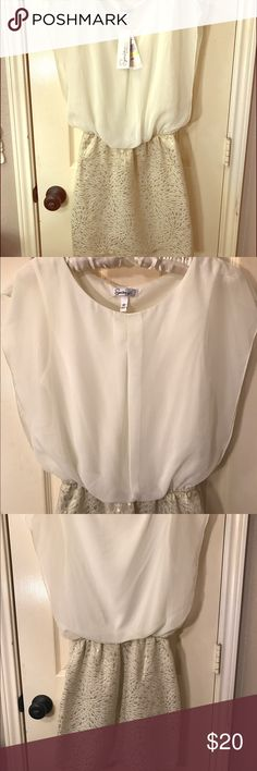 Cream Blouse w/ Cream & Gold Jacquard Skirt One Piece Dress with Sheer Blouse and attached Jacquard Fabric Skirt. Lined throughout. Side Zip. Elastic Waistband. Fitted Skirt, Blousy Top. Brand New with Tags Attached. Speechless Dresses